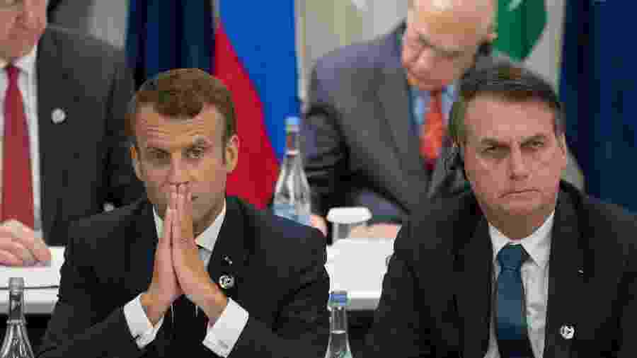 Presidente da França, Emmanuel Macron, ao lado do presidente brasileiro Jair Bolsonaro durante cúpula do G20 - Jacques Witt/Pool/AFP