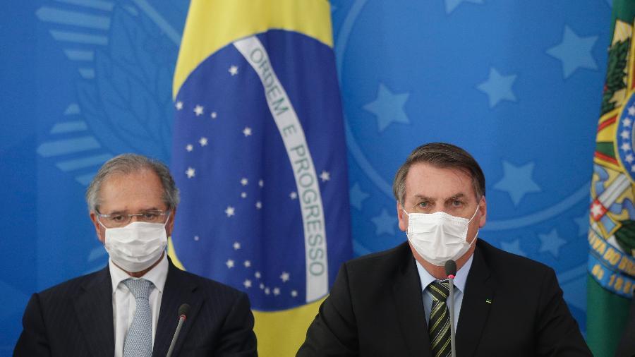 A MP 966 foi assinada por Jair Bolsonaro, Paulo Guedes (ambos na foto) e pelo ministro da Controladoria-Geral da União - Dida Sampaio/Estadão Conteúdo
