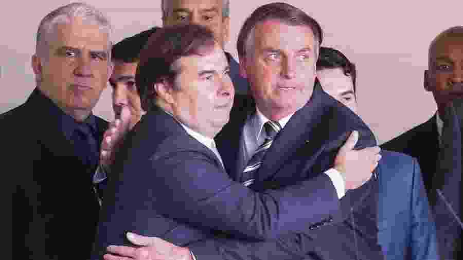 Foto do presidente Jair Bolsonaro (sem partido) e do presidente da Câmara dos Deputados Rodrigo Maia (DEM), de 4.jun.2019 - Andre Coelho/Folhapress
