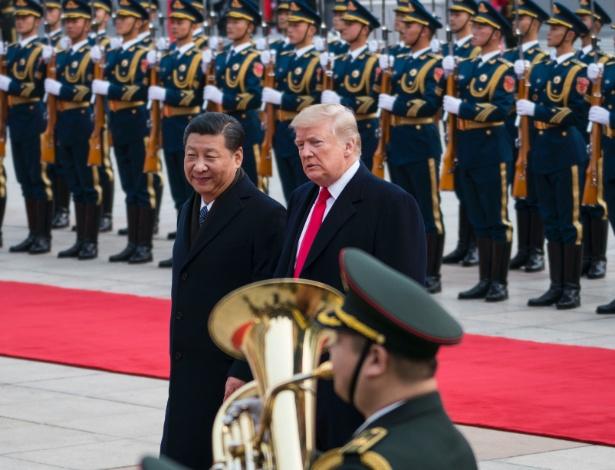 Presidente dos EUA, Donald Trump, e o presidente chinês, Xi Jinping, durante cerimônia em Pequim