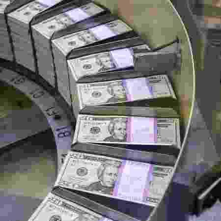 Documento mostrou que os estímulos resultantes à economia global podem render ao menos 153 bilhões de dólares em 2020-21 - Eva HAMBACH / AFP