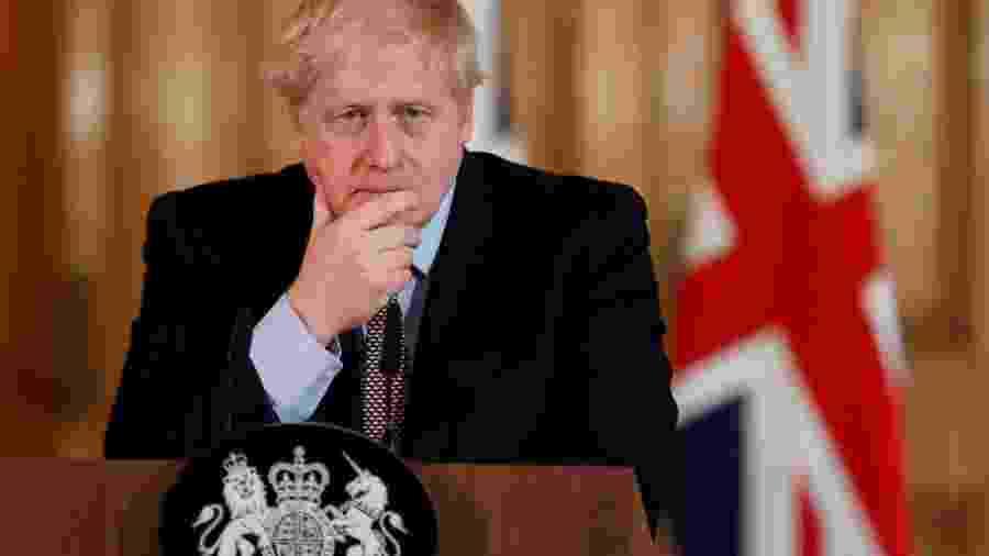Premiê britânico, Boris Johnson, durante entrevista coletiva sobre o coronavírus - POOL New