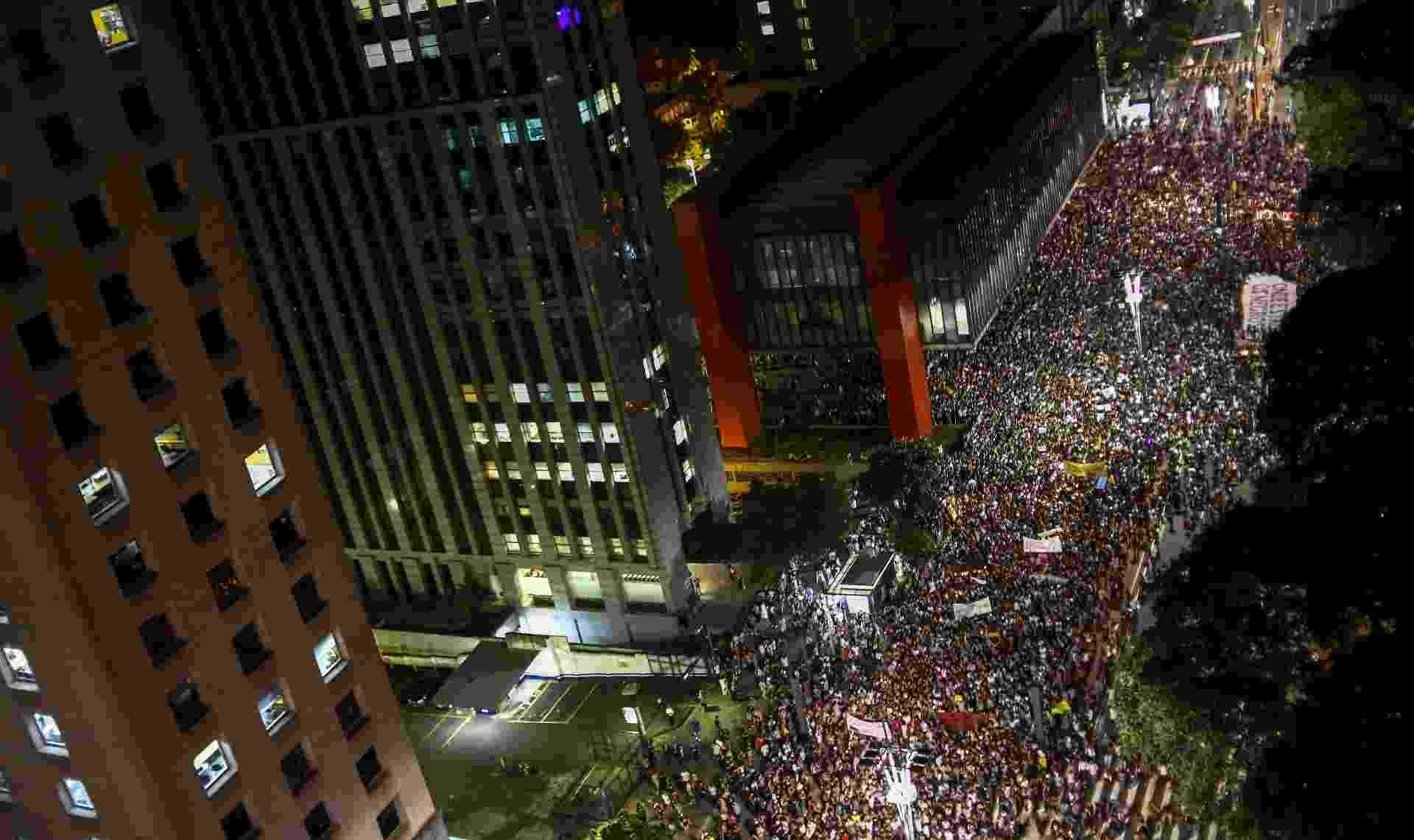 15.mar.2018 - Milhares se reúnem na Avenida Paulista, em São Paulo, para fazer uma homenagem à Marielle Franco - Miguel Schincariol/AFP
