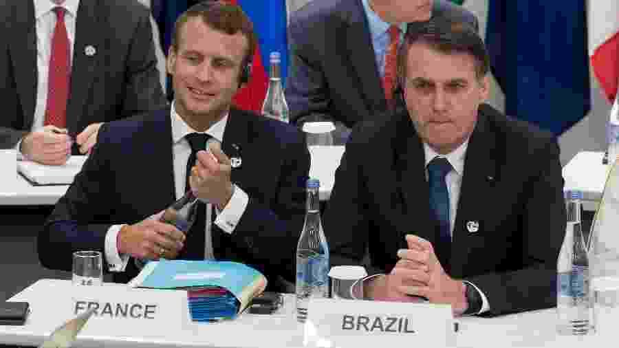 Os presidentes Emmanuel Macron (França)  e Jair Bolsonaro (Brasil) - Jacques Witt - 28.jun.2019/AFP