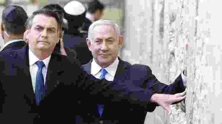 Em gesto histórico, Jair Bolsonaro visita o Muro das Lamentações, acompanhado do premiê Benjamin Netanyahu - Menahem Kahana/AFP