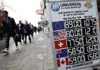 Por que a moeda britânica pode cair ainda mais - Adrian Dennis/AFP
