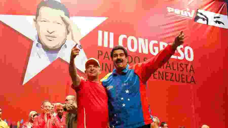 27.jul.2014 - Hugo Carvajal ao lado do presidente venezuelano, Nicolás Maduro - AFP