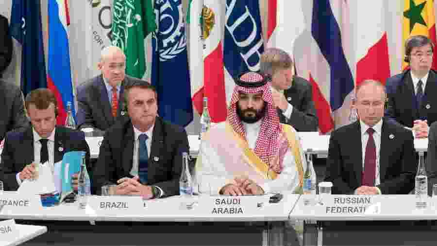 Presidente francês Emmanuel Macron, presidente brasileiro Jair Bolsonaro, príncipe herdeiro saudita Mohammed Bin Salman e o presidente russo Vladimir Putin durante reunião sobre economia digital realizada pelo G-20 em 2019 - Jacques Witt / POOL / AFP