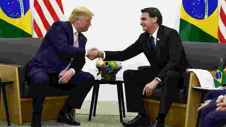 28.jun.2020 - O presidente Jair Bolsonaro se encontra com Donald Trump (EUA) no G20 - Brendan Smialowski/AFP