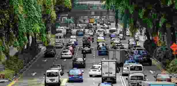 Motoristas entram no distrito financeiro em Cingapura - Roslan Rahman/ AFP