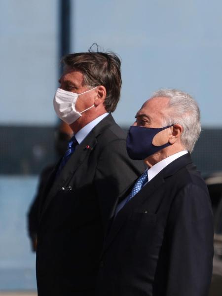 Jair Bolsonaro e Michel Temer em evento no ano passado - Henrique Barreto/Futura Press/Estadão Conteúdo