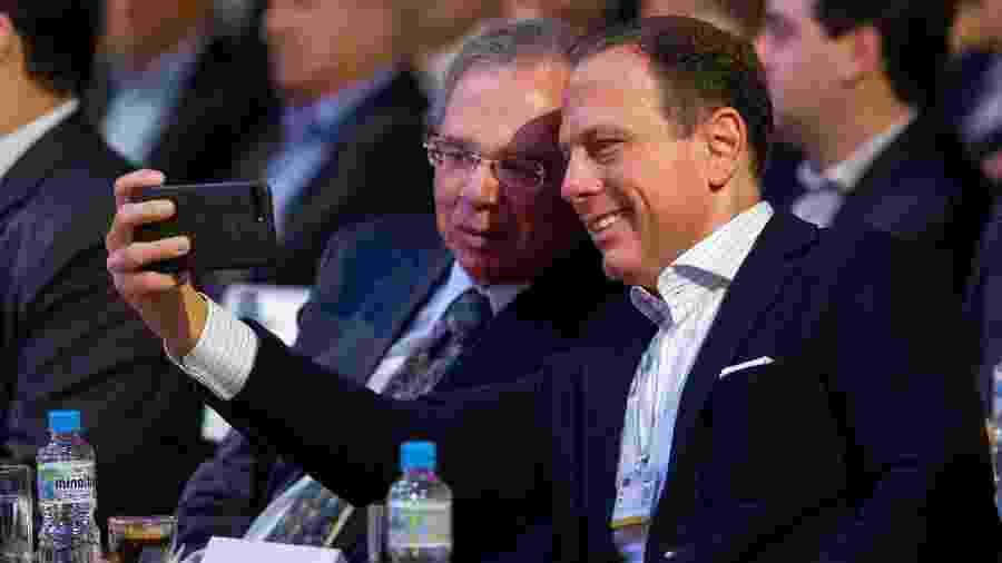 Paulo Guedes e o governador de São Paulo, João Doria, durante evento para empresários - Roberto Vazquez/Futura Press/Estadão Conteúdo