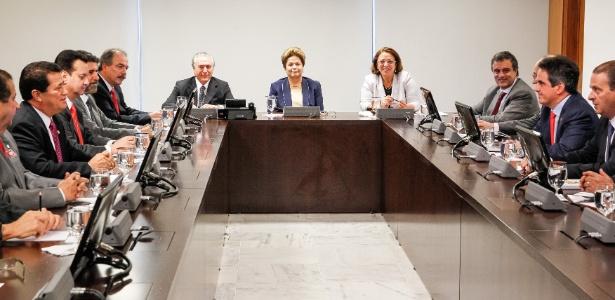 Dilma e Temer durante reunião no Planalto em 2013