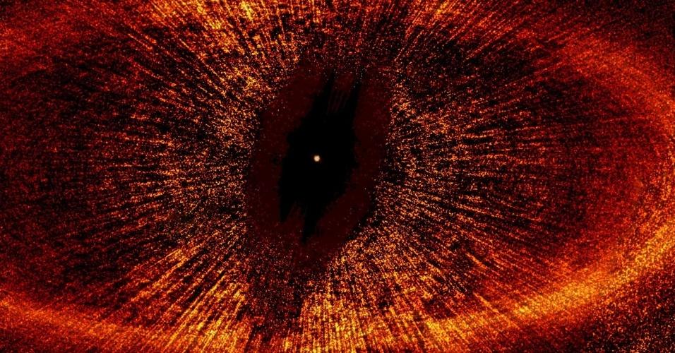 11.jul.2013 - Como planetas não emitem luz própria, os cientistas observam alterações nas estrelas para caçar novos mundos ao redor desses corpos massivos. Mas uma descoberta da Nasa (Agência Espacial Norte-Americana) afirma que alguns desses novos candidatos à Terra são apenas miragens do espaço. É que a gravidade de um planeta que orbita uma estrela em um disco de poeira, como a famosa Fomalhaut (ponto branco, no centro da imagem), pode esculpir buracos na roda de sujeira (bordas vermelhas). A não ser que esse anel abrigue tanto gás quanto poeira, relata estudo publicado na revista Nature. As lacunas que existem nessa estrela, localizada a 25 anos-luz de distância, podem não ser sinal de um novo planeta, mas, sim, de muito gás que nunca tinha sido visto antes