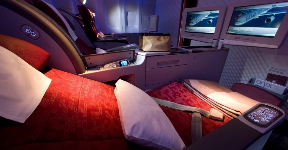 Assento da classe executiva da Qatar Airways