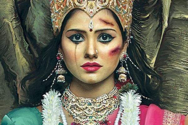 9.set.2013 - Nesta imagem, a deusa suprema do hinduísmo, Durga, também aparece com marcas de agressão no rosto. Na Índia, acredita-se que esta deusa é a encarnação do feminino e da energia criativa