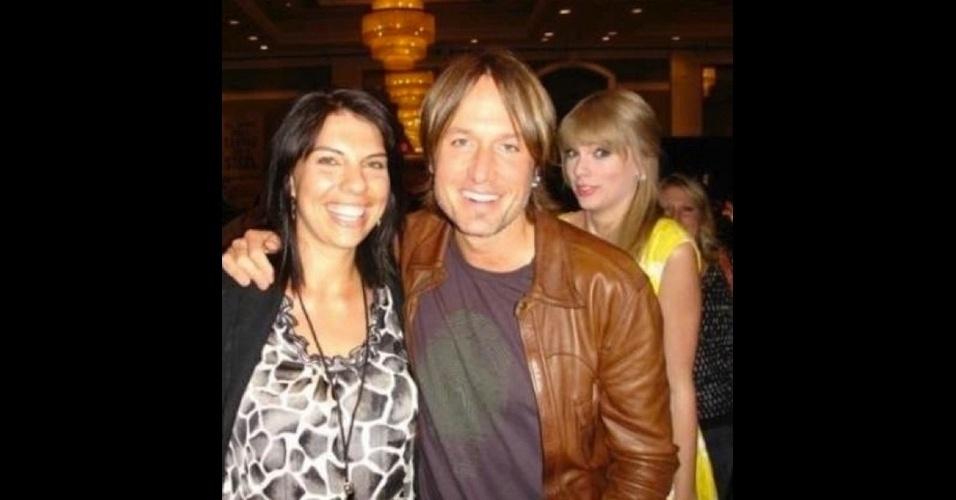 O músico Keith Urban tem foto ''estragada'' pela cantora Taylor Swift