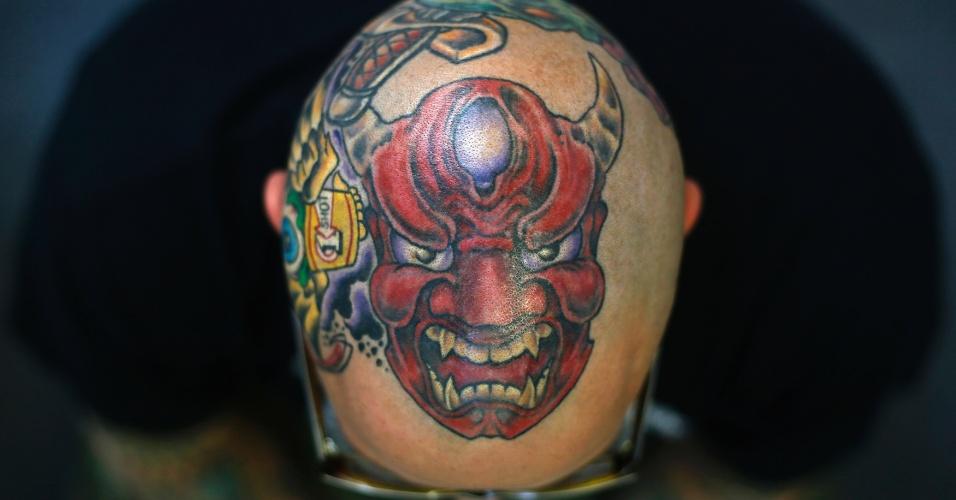 27.set.2013 - Matt Grosso exibe tatuagem na cabeça durante a 9ª Convenção Internacional de Tatuagem em Londres, na Inglaterra