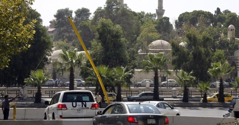 28.set.2013 - Veículos transportam neste sábado (28) inspetores da ONU que investigam a presença de armas químicas na Síria. O Conselho de Segurança das Nações Unidas, na última sexta-feira (27), condenou o uso de armas químicas pelo regime de Assad