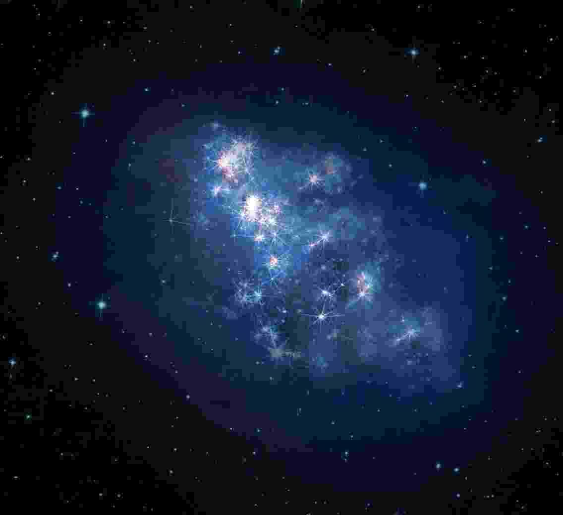 """23.out.2013 -Astrônomos encontraram a mais distante galáxia até agora, permitindo que os cientistas """"enxerguem"""" o Universo tal qual era cerca de 700 milhões de anos após o início. A luz da galáxia, batizada de z8_GND_5296, levou cerca de 13,1 bilhões de anos-luz para chegar ao Telescópio Orbital Hubble e ao Observatório Keck, no Havaí - V. Tilvi, S.L. Finkelstein/C. Papovich/Hubble Heritage Team"""
