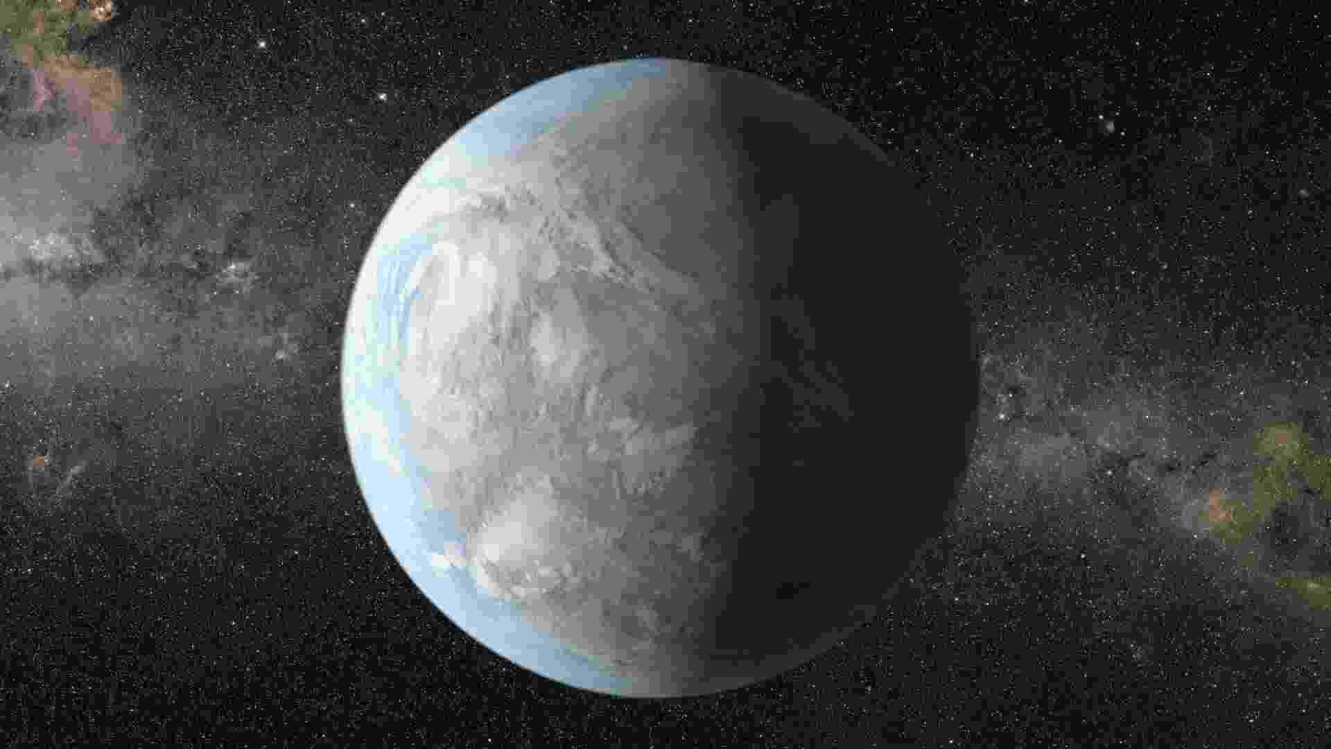 5.nov.2013- Uma em cada cinco estrelas similares ao Sol na Via Láctea possuem planetas do tamanho da Terra, que poderiam abrigar vida, revela novo estudo da Nasa (Agência Espacial Norte-Americana). Na imagem, impressão artística do Kepler-62e, uma super-Terra na zona habitável de uma estrela menor e mais fria que o Sol, a 1.200 anos-luz de distância - Reuters/Nasa/JPL-Caltech