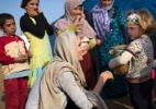 ONG oferece SMS grátis e 0800 para unir refugiados sírios com suas famílias - A.McConell/UNHCR/Reuters