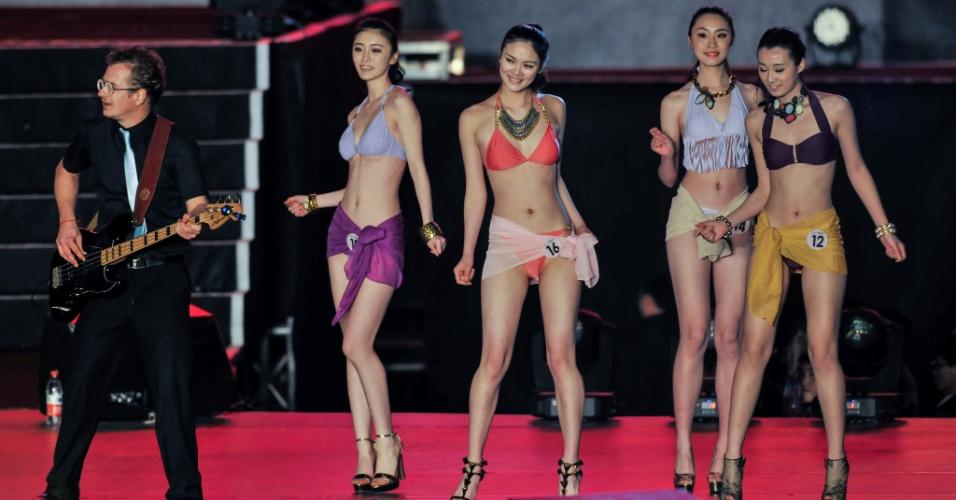 9.mar.2014 - Modelos disputam o título de Miss Turismo Internacional 2014 em Chengdu, capital da província de Sichuan, no sudoeste da China. A campeã vai assistir à final mundial do MTI 2014, nos Estados Unidos, em agosto deste ano