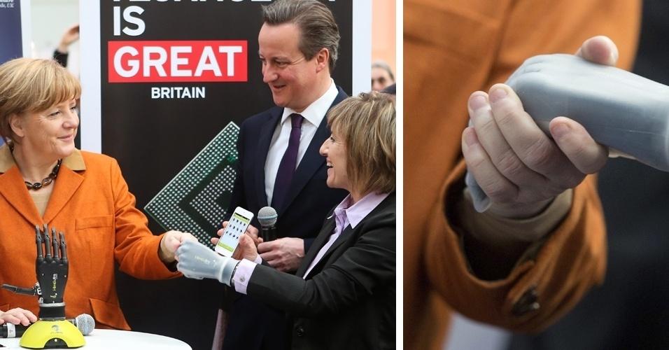 10.mar.2014 - A chanceler alemã Angela Merkel (esq.), cumprimenta uma prótese de mão controlada por smartphone na feira de tecnologia Cebit, realizada anualmente na cidade de Hanover. O primeiro-ministro britânico, David Cameron, também esteve no local -- o Reino Unido é o país homenageado na edição deste ano