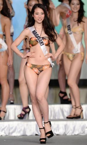 18.mar.2014 - Keiko Tsuji, 20, estudante, desfila de biquíni durante o Miss Japão 2014. Ela concorreu com outras 42 beldades para ganhar o título. A bela vai representar seu país no Miss Universo este ano