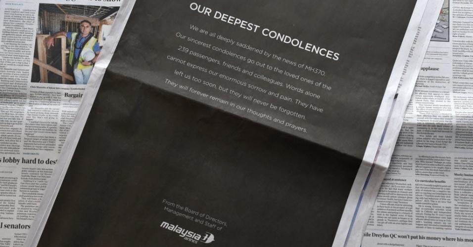 """27.mar.2014 - Anúncio da Malaysia Airlines publicado em jornal australiano oferece """"nossas mais profundas condolências"""" pelo desaparecimento do voo MH370, em 8 de março. Acredita-se que o avião, que levava 239 pessoas a bordo, tenha caído no oceano Índico"""