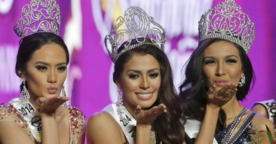 30.mar.2014 - Mary Jean Lastimosa (centro) foi coroada Miss Filipinas 2014 em concurso realizado em Manila e vai representar seu país no Miss Universo. Kris Tiffany Janson (à direita) foi eleita Miss Filipinas Intercontinental e Yvethe Marie Santiago (à esquerda) foi eleita Miss Supranational