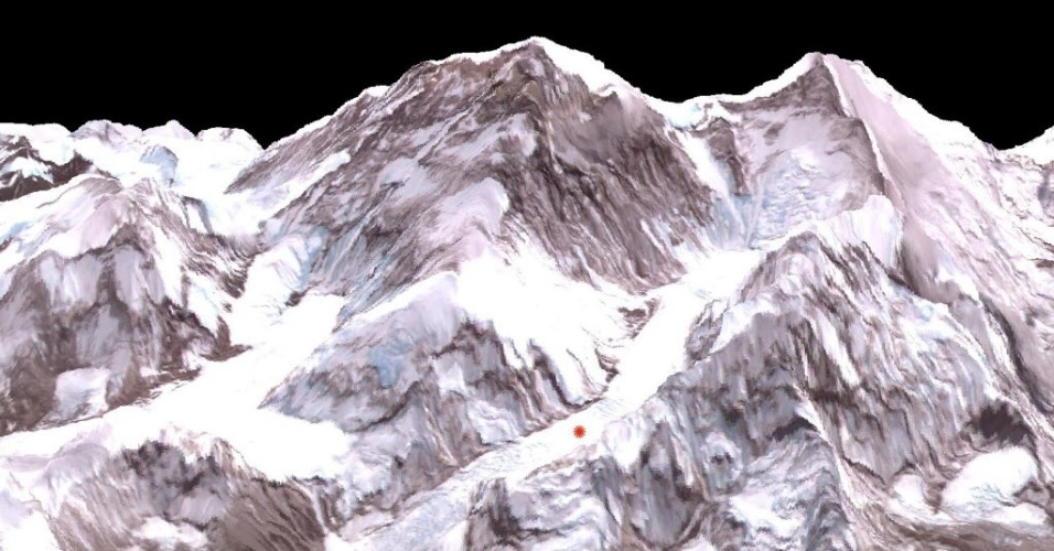 """29.abr.2014 - Imagem divulgada pela Nasa nesta terça-feira (29) mostra o rastro da última avalanche no Everest, que provocou a morte de 13 guias no dia 26 de abril. A imagem foi gerada por um veículo espacial da agência norte-americana nesta segunda-feira (28). A avalanche ocorreu no ponto vermelho da foto, área conhecida como """"campo de pipoca"""", cercado por paredões de gelo"""