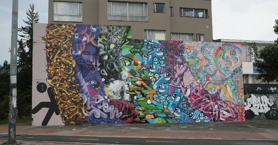 """O grafite """"Peso"""" foi feita pelos artistas Skore, Ospen, Exs, Skida e Pez. A obra foi feita em um muro de Bogotá (Colômbia)"""