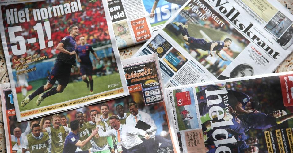 14.jun.2014 - As primeiras páginas de vários jornais holandeses destacam neste sábado (14) a vitória da seleção do país por 5 a 1 contra a Espanha, atual campeã, na Copa do Mundo do Brasil