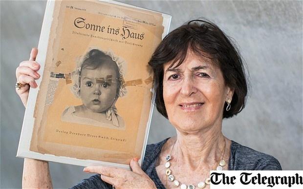 2.jul.2014 - A professora Hessy Taft, 80, segura o exemplar da revista nazista 'Sonne ins Haus'. Judia, a criança foi eleita como o 'bebê ariano perfeito', sem que o partido nazista soubesse sua origem
