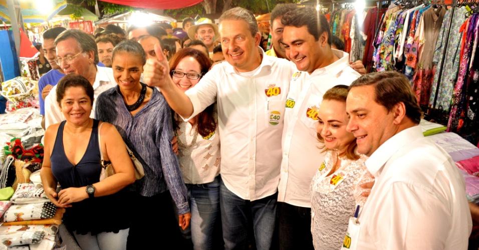 18.jul.2014 -  O candidato do PSB à Presidência da República, Eduardo Campos, e sua vice, Marina Silva, visitam uma feira agropecuária durante campanha na cidade do Crato, no Ceará, nesta sexta-feira (18)