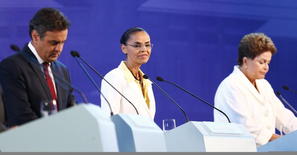 16.set.2014 - Aécio Neves (PSDB), Marina Silva (PSB) e Dilma Rousseff (PT) se posicionam para o início do debate promovido pela CNBB (Conferência Nacional dos Bispos do Brasil), em Aparecida, interior de São Paulo, nesta terça-feira (16)
