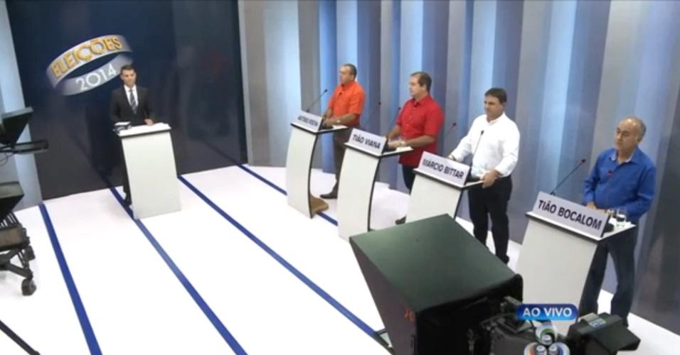 30.set.2014 - Da esquerda pra direita, os candidatos ao governo do Acre Antônio Rocha (PSOL), Tião Viana (PT), Márcio Bittar (PSDB) e Tião Bocalom (DEM) participaram de debate na TV Acre, afiliada da Rede Globo, nesta terça-feira (30)