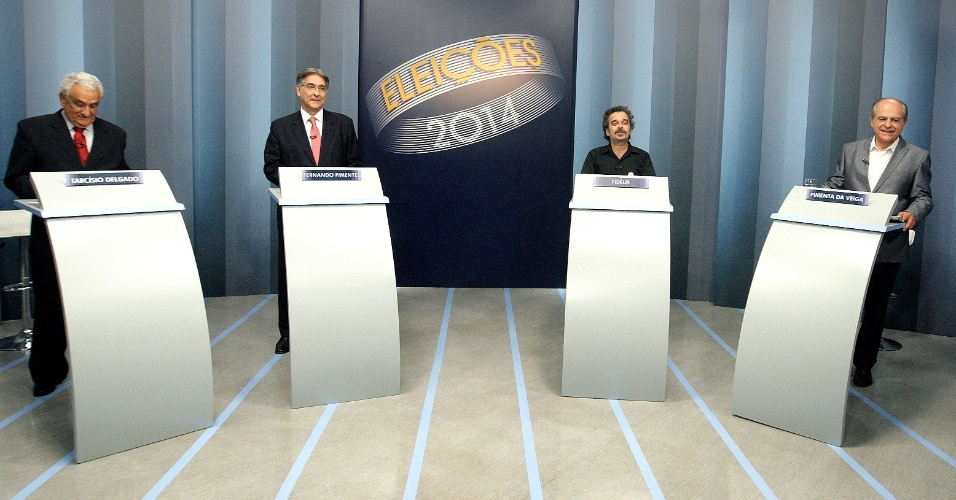 30.set.2014 - Os principais candidatos ao governo de Minas Gerais participam de debate promovido pela rede Globo Minas, em Belo Horizonte, nesta noite. Na liderança, Fernando Pimentel (PT) foi acusado pelos rivais de ter responsabilidade em problemas do governo federal, por ter sido ministro do Desenvolvimento Indústria e Comércio Exterior do governo Dilma