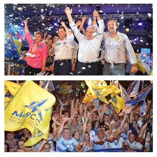 2.out.2014 - O candidato do PSD ao Senado por Goiás, Vilmar Rocha (com os braços levantados), acompanha o candidato do PSDB ao governo de Goiás, Marconi Perillo (com o microfone na mão), durante uma reunião com servidores públicos estaduais, nesta quinta-feira (2), em Goiás