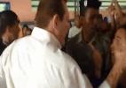 Candidato que agrediu eleitora se apresenta à Polícia Civil - Reprodução/TNH1