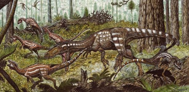Um dinossauro Tachiraptor admirabilis aparece perseguindo dinossauros herbívoros da espécie Laquintasaura nesta ilustração. Esse réptil teria vivido no período Jurássico há 200 milhões de anos e seus ossos foram encontrados na Venezuela - Reprodução