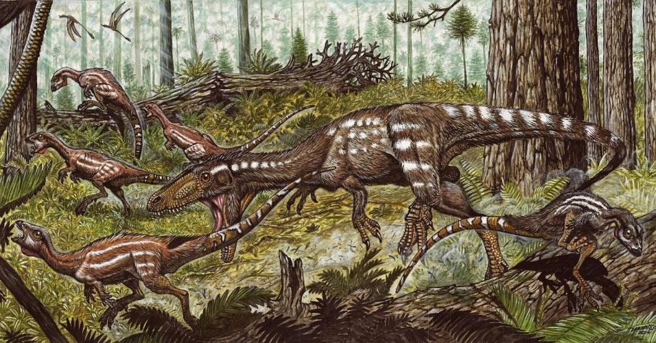 8.out.2014 - Um dinossauro Tachiraptor admirabilis aparece perseguindo dinossauros herbívoros da espécie Laquintasaura nesta ilustração. Esse réptil teria vivido no período Jurássico há 200 milhões de anos e seus ossos foram encontrados na Venezuela