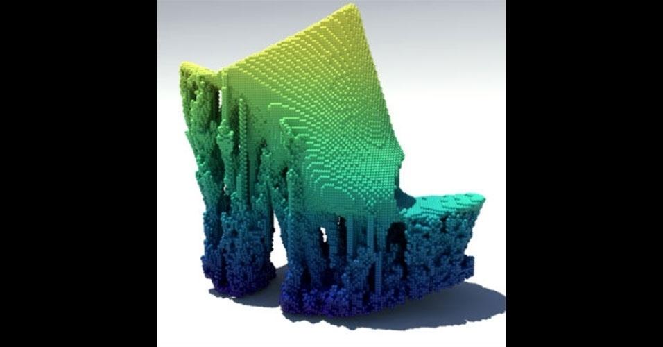 """O designer Francis Bitonti desenvolveu com uso de impressoras 3D um par de sapatos pixelados. Segundo a versão norte-americana da revista """"Wired"""", Bitonti primeiramente imprimiu vários pedaços de plástico para depois montar os sapatos, deixando os calçados com esse formato. Desenvolvido em parceria com a Adobe, os sapatos, por enquanto, são apenas um protótipo"""