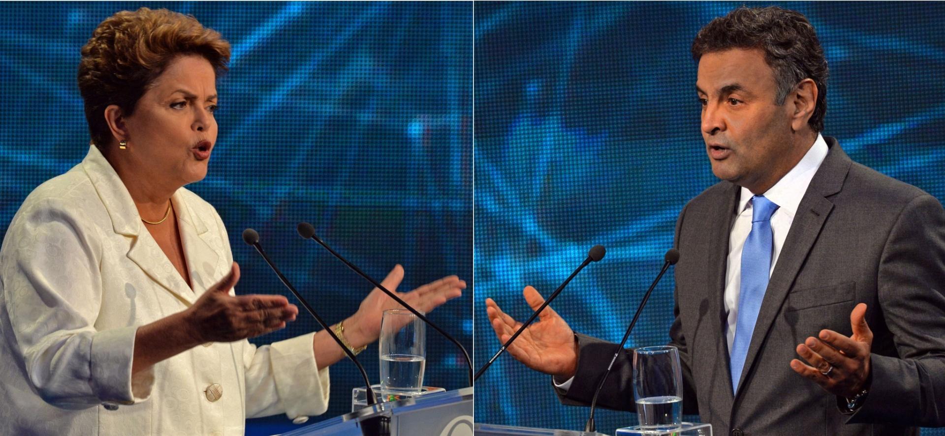 14.out.2014 - A candidata à reeleição, presidente Dilma Rousseff (PT), e o candidato à Presidência Aécio Neves (PSDB) participam do debate da Band, o primeiro do segundo turno das eleições presidenciais, na noite desta terça-feira