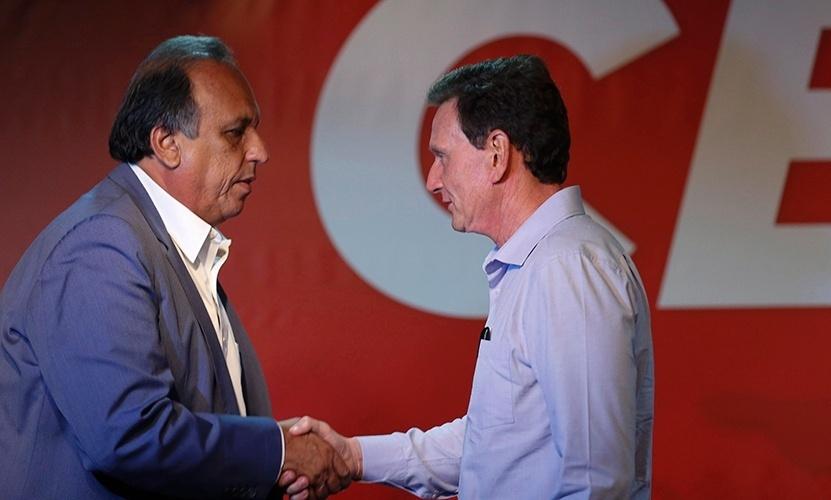 14.out.2014 - Os candidatos ao governo do Rio de Janeiro, Luis Fernando Pezão (PMDB) e Marcelo Crivella (PRB), participam de debate na Rádio CBN