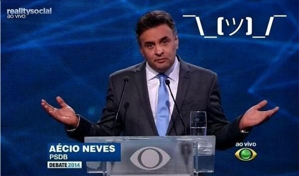 14.out.2014 - Gesto do candidato à Presidência Aécio Neves (PSDB), durante debate da Band na noite desta terça-feira, virou meme nas redes sociais