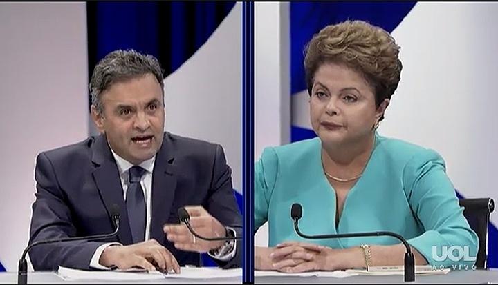 16.out.2014 - No primeiro bloco do debate entre presidenciáveis promovido pelo UOL, SBT e Jovem Pan, os candidatos Aécio Neves (PSDB) e Dilma Rousseff (PT) discutiram nepotismo e corrupção no governo
