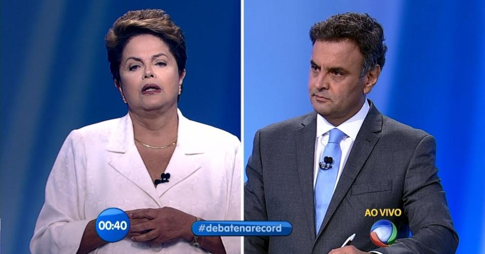 19.out.2014 - A presidente Dilma Rousseff (PT), candidata à reeleição, e Aécio Neves, candidato do PSDB à Presidência, participam de debate do segundo turno das eleições promovido pela Record, neste domingo (19)