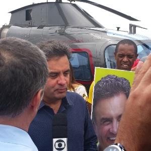 Aécio desembarca de helicóptero que o levou ao cume do santuário